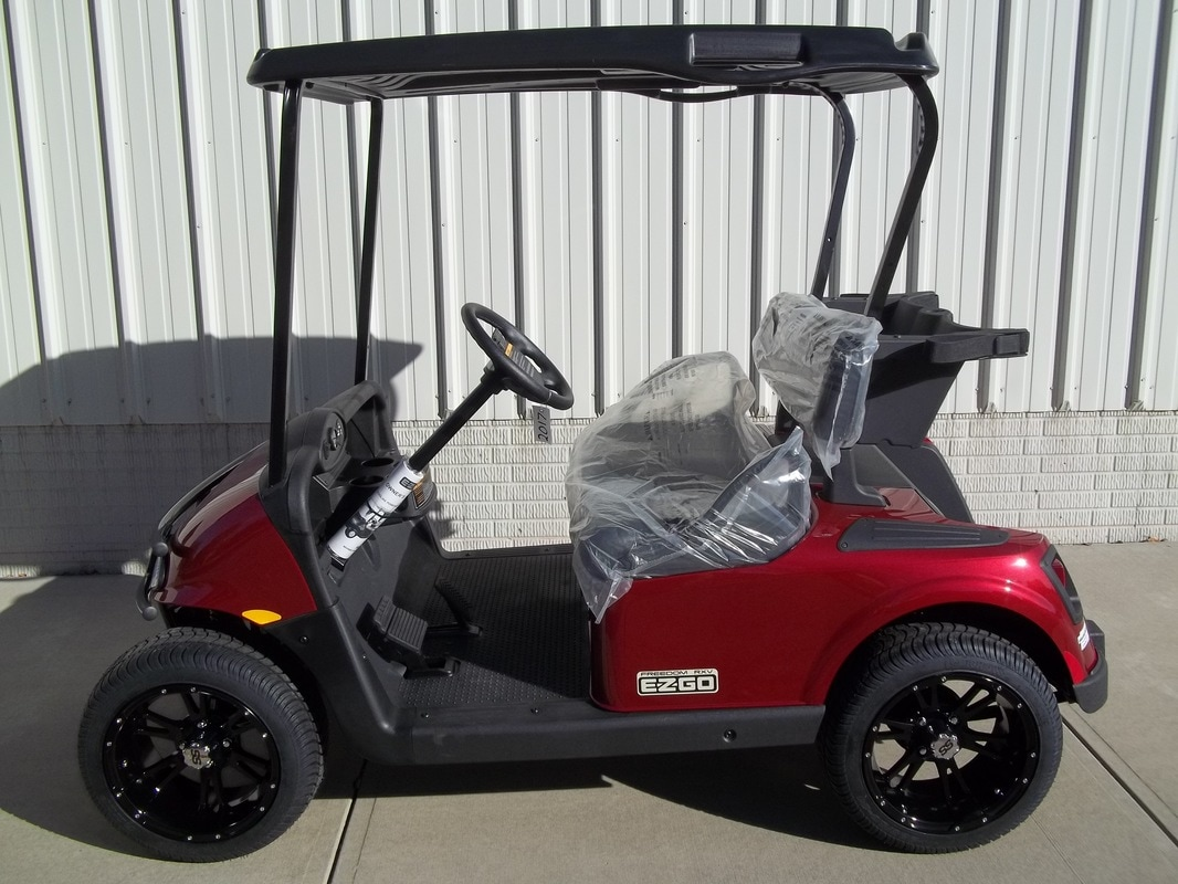 2016 E-Z-GO TXT LX, Gas, Jacobson Orange, Freedom(Includes Head-Tail-Brake Lights, Horn, Fuel Gauge & Oil Light, 19 M.P.H.), Custom Black & Orange Seats, Black Top, 12'' Cragar Wheels, MR. Golf Car Inc. Springfield South Dakota