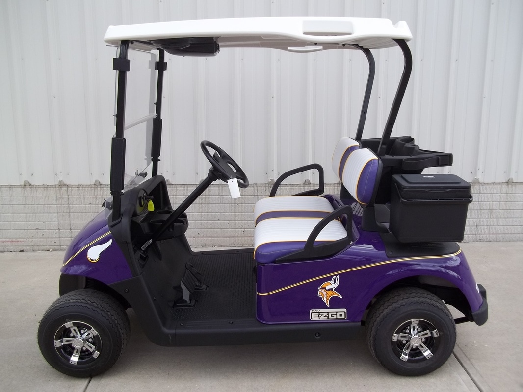 2012 E-Z-GO RXV Custom Painted Purple with Vikings Decals, Custom White & Purple Seats with Yellow Piping & Stitching, Electric 48-V (6-8V) Trojan Batteries, White Top, Bluetooth Radio, Yellow Pinstripe, Clear Folding Windshield, Deluxe Cooler, Side Basket, Vegas Hubcaps