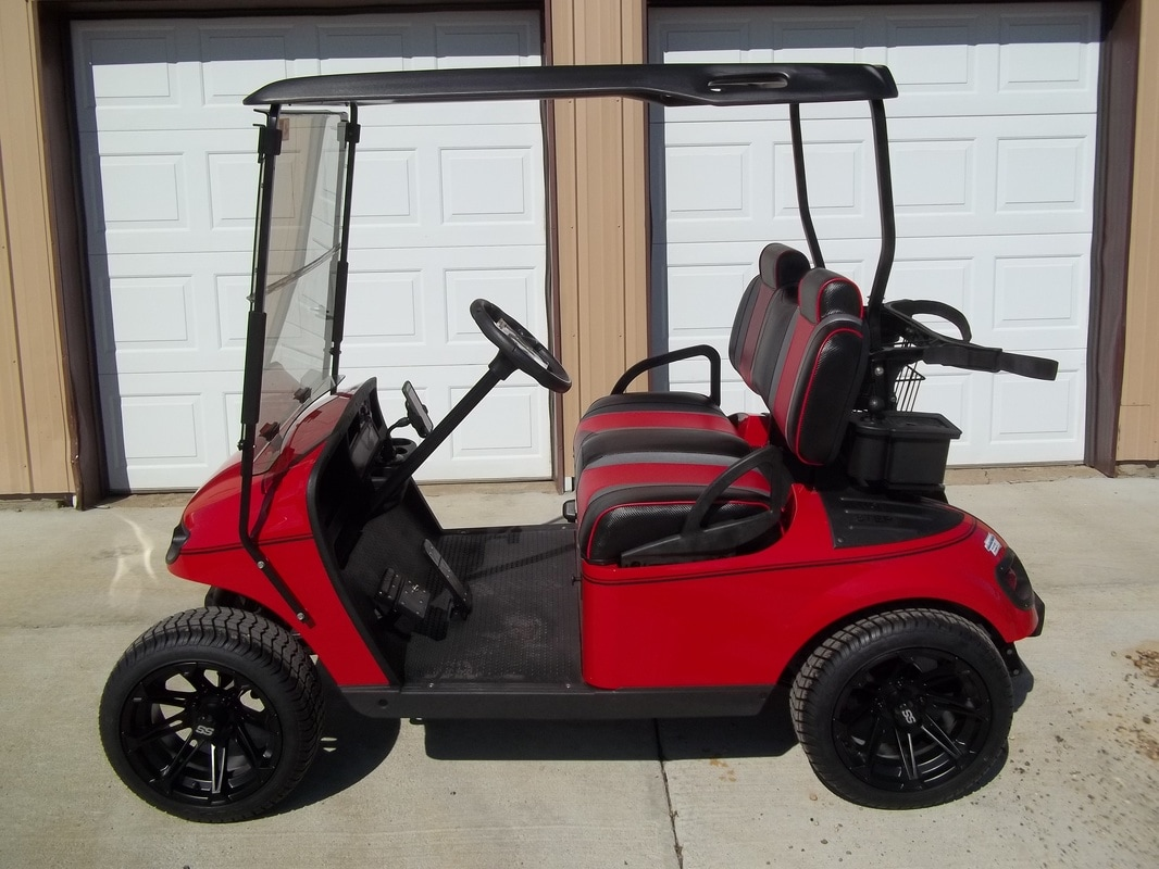 2007 E-Z-GO TXT LX Gas, Flame Red, LX Body, Custom Black & Red Seats, Black Top, L.E.D. Head & Tail Lights, Dual USB Port, Custom Carbon Fiber Steering Wheel & Score Card Holder, Tinted Folding Windshield, Black Ball Washer, Deluxe Cooler, Matte Black Pinstripe, 2