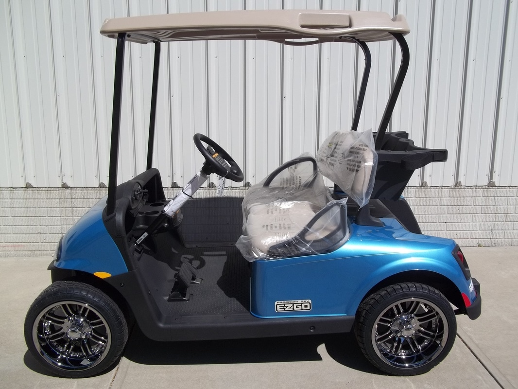 2017 E-Z-GO RXV Electric 48volt Kinetic Blue Limited Edition 14 inch wheels New Stone Beige Seats & Top Freedom Lights