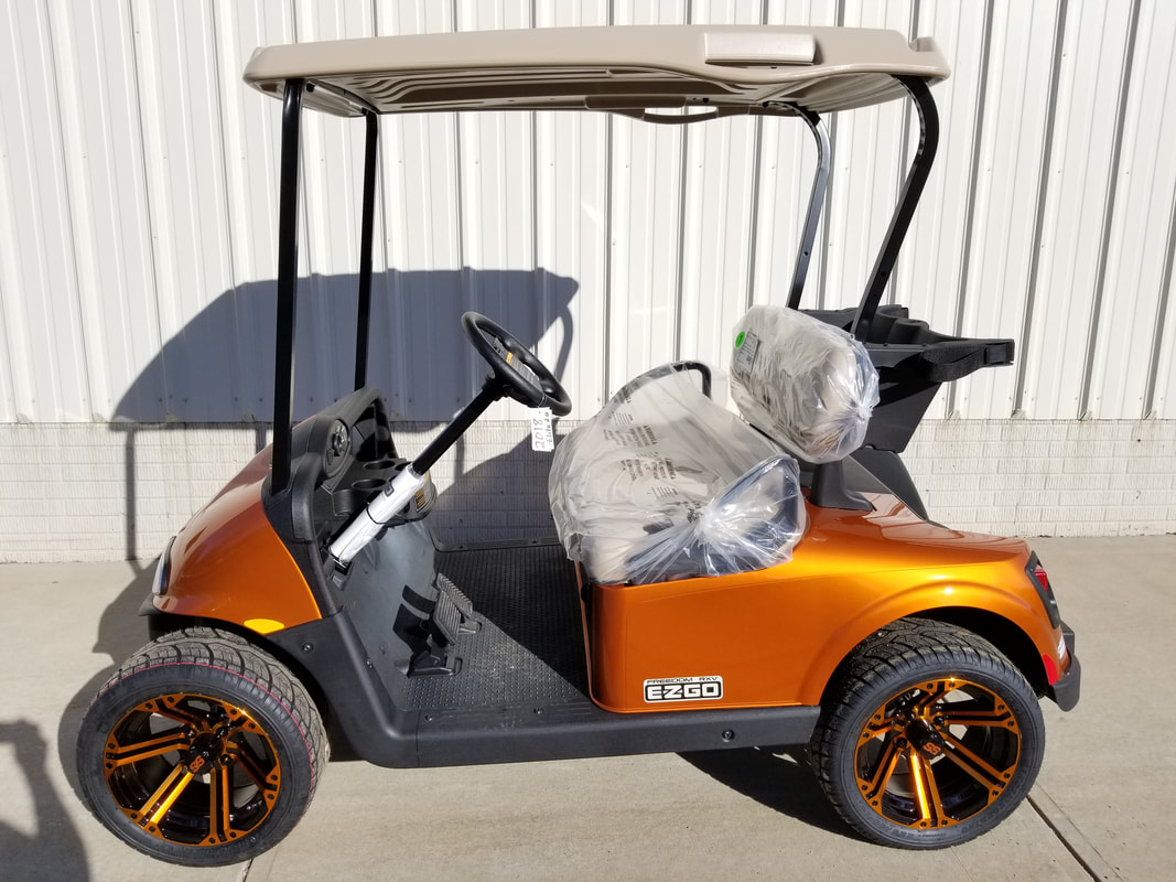 2018 E-Z-GO RXV ELiTE 2.0 NEW Sunburst Orange, Stone Beige Seats & Top, Electric 2.0 Samsung Lithium Ion Batteries (5-Year Free Replacement on Batteries), Freedom (Includes Head-Tail-Brake Lights, Horn, State of Charge Meter, 19.5 MPH), 14